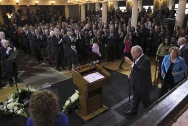 Menino and his wife, Angela, received a standing ovation as they took the podium as Faneuil Hall Thursday to announce his decision.